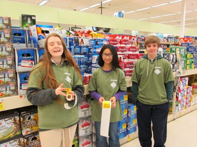 Pinkerton students Amber, Violet and Aiden help to remind community for the holidays that it is against the law to provide alcohol to minors by applying the Buyer Beware stickers to all multipacks of beer at Shaw's in Derry. Thank you to Shaw's for supporting this important effort!